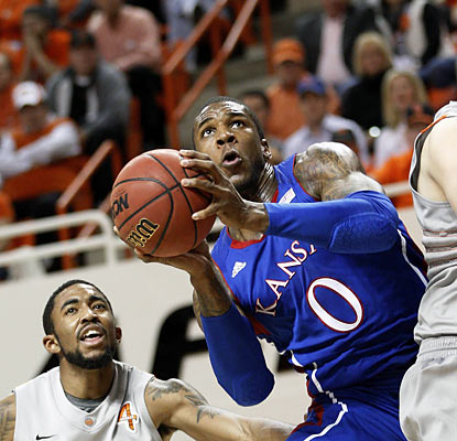 Thomas Robinson provides 17 points and a game-high 12 rebounds as the Jayhawks fend off the pesky Cowboys. (AP)
