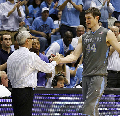 Coach Roy Williams congratulates Tyler Zeller, who scores 30 points in his final home game. (AP)