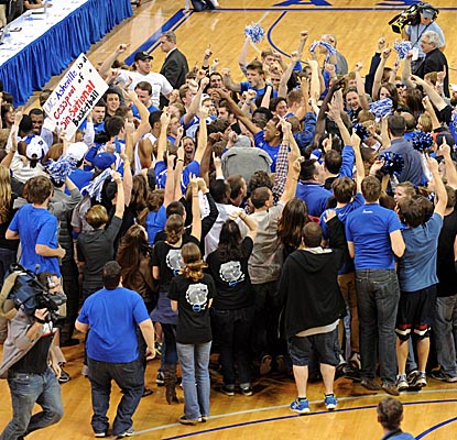 UNC-Asheville fans storm the court after their Bulldogs roll past VMI to a Big South Conference title. (US Presswire)