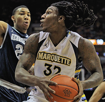 Jae Crowder carries Marquette with 26 points and 14 rebounds in his final home game for the Golden Eagles.  (Getty Images)