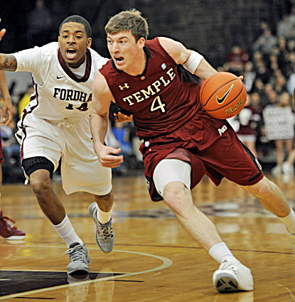 Temple's Juan Fernandez (right) scores 19 points to lead the Owls to an 80-60 victory over Fordham. (AP)