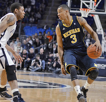 Trey Burke scores 19 as Michigan claims a share of the Big Ten title for the first time since 1986. (AP)