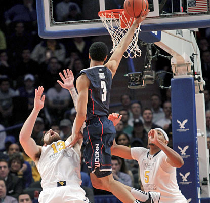 Jeremy Lamb (22 points) gets the basket and draws a foul during UConn's second-half rally.  (AP)