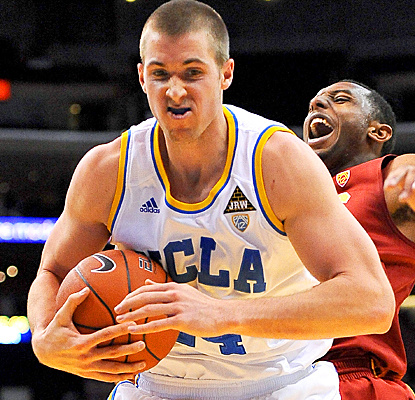 Travis Wear helps the Bruins advance to the Pac-12 quarterfinals with 12 points and eight rebounds against USC. (US Presswire)