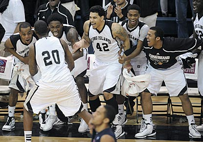 Booker Hucks (20) pumps up his LIU teammates as the Blackbirds wrap up the fifth NCAA bid in program history.  (AP)