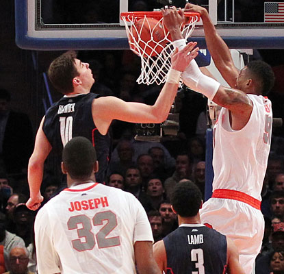 Fab Melo slams home two points as Syracuse's 11th straight victory puts the Orange in the Big East semifinals.  (US Presswire)