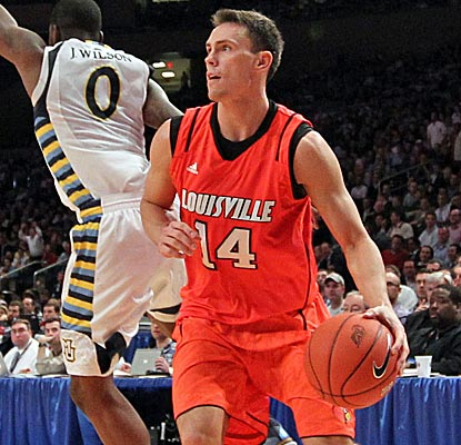Kyle Kuric leads the way with 20 points for Louisville, which forces Marquette into 26 turnovers.  (US Presswire)