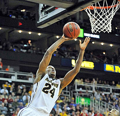Missouri's Kim English scores 20 of his 27 points as the Tigers move to the semis.  (US Presswire)
