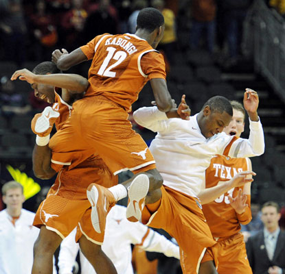 The Longhorns celebrate a big win over Iowa State that could ensure a bid to the NCAA tournament.  (US Presswire)