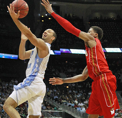 Kendall Marshall runs the UNC offense to perfection, dishing out 12 assists while scoring 13 points.  (AP)