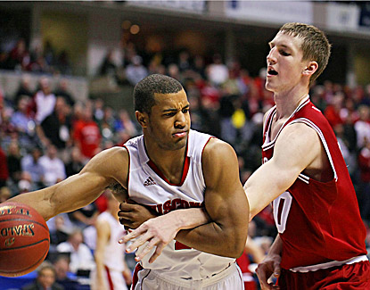 Wisconsin's Jordan Taylor drives past Indiana's Cody Zeller while scoring 12 points in the Badgers' 79-71 win. (US Presswire)
