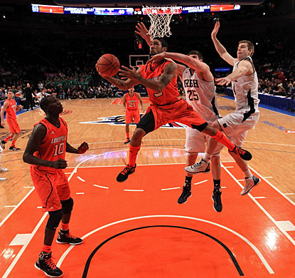 Peyton Siva (3) scores 13 points for Louisville and flirts with a triple-double with nine assists and eight rebounds. (Getty Images)