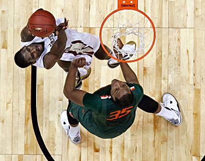 Michael Snaer (left) scores 20 points to lead Florida State past a short-handed Miami team to advance.  (Getty Images)
