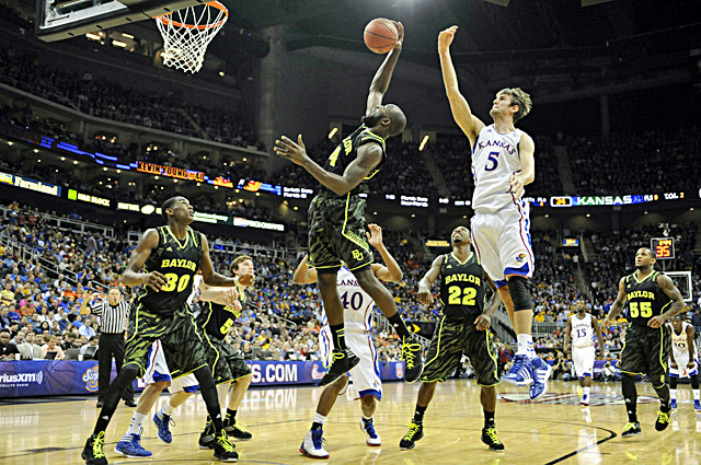 Baylor's Quincy Acy (center) grabs a rebound in front of Kansas' Jeff Withey in the Bears' win. (US Presswire)