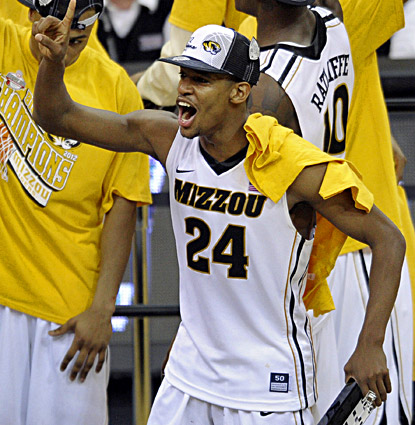 Kim English scores 19 points and celebrates Missouri's Big 12 title win over Baylor. Next year the Tigers will be in the SEC. (AP)