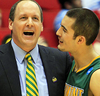 Vermont head coach John Becker celebrates with Four McGlynn after landing the Catamounts' second win in NCAA tournament play. (AP)