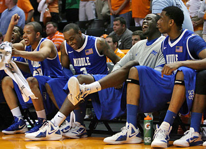 Middle Tennessee players are all smiles as they knock of the top-seeded Vols in the second round. (AP)