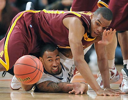 Minnesota's Andre Hollins (top) and Washington's Desmond Simmons watch the ball squirt away during the second half. (Getty Images)