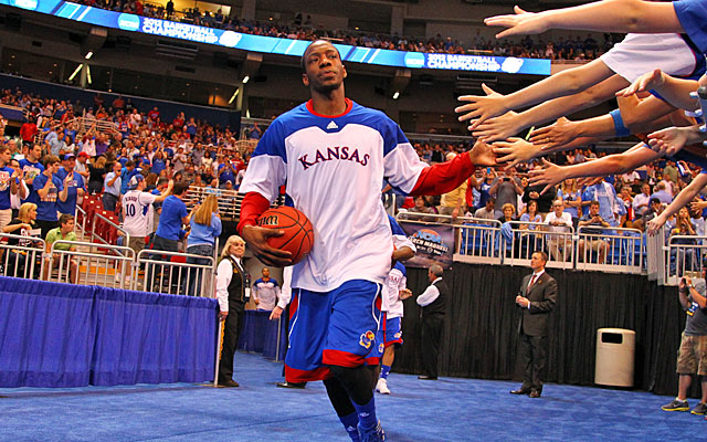 Point guard Tyshawn Taylor sparks Kansas' transition game but is struggling from outside. (Getty Images)