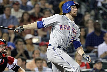 Mets first baseman Ike Davis connects for a three-run homer to break a 1-1 tie in the sixth inning.  (AP)