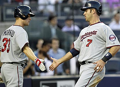 Justin Morneau and Joe Mauer combine for five hits as the Twins earn just their third win of the year.  (AP)