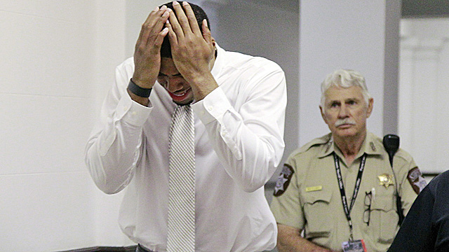 Darrell Williams, left, weeps as he is escorted from the courtroom in Stillwater, Okla. (AP)