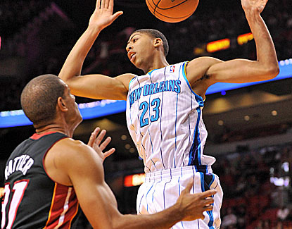 Hornets rookie power forward Anthony Davis dunks on Heat small forward Shane Battier. (US Presswire)