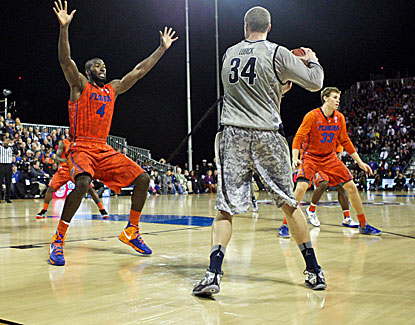 Florida and Georgetown play a full half of basketball on the USS Bataan before the cancellation. (US Presswire)