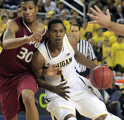 Glenn Robinson III provides 21 points and six boards as the Wolverines take care of business against IUPUI. (AP)