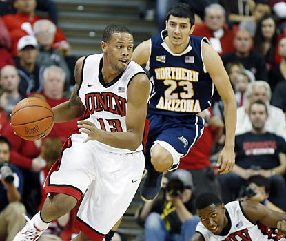 Bryce Dejean-Jones scores 15 points off the bench as UNLV rolls in its season opener. (AP)