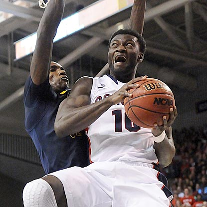 Gonzaga forward Guy Landry Edi tries to go up and around West Virginia's Aaric Murray for a shot in the second half.  (US Presswire)