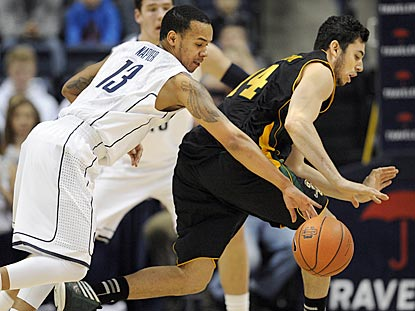 Connecticut junior Shabazz Napier steals the ball from Vermont's Josh Elbaum during the first half.  (AP)