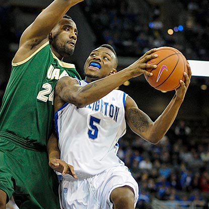 Creighton's Josh Jones, who scores all 18 of his points in the second half, drives on UAB's Preston Purifoy.  (Getty Images)