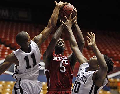NC State's C.J. Leslie has his shot blocked Thursday in the Wolfpack's 72-55 win over Penn State.  (AP)
