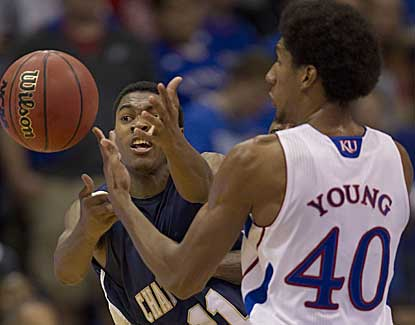 Chattanooga guard Ronrico White knocks the ball from Kansas forward Kevin Young.  (AP)