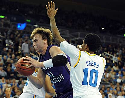 UCLA's Larry Drew II applies pressure to James Madison's Gene Swindle on Thursday night. (US Presswire)