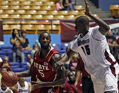 NC State's C.J. Leslie drives by Cady Lalanne of UMass in the Wolfpack's 94-76 win. (AP)
