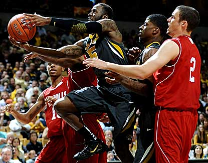 Missouri guard Keion Bell drives through traffic Friday in the Tigers' win over Nicholls State. (US Presswire)