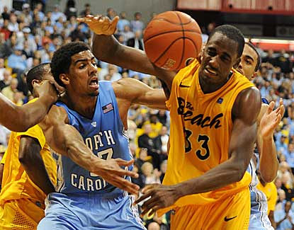North Carolina's James Michael McAdoo battles with Long Beach State's Nick Shepherd. (US Presswire)