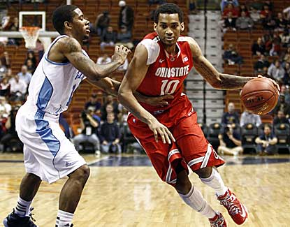 Ohio State forward LaQuinton Ross drives past Rhode Island's Mike Powell on Saturday. (US Presswire)