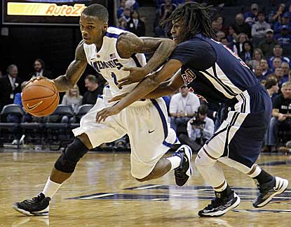 Memphis guard Joe Jackson drives past Samford's Russell Wilson during the Tigers' 65-54 win. (AP)