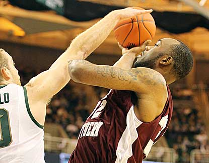 Michigan State's Matt Costello stuffs Texas Southern's Aaron Clayborn on Sunday. (US Presswire)