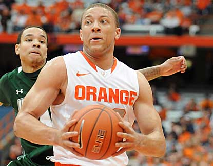 Syracuse guard Brandon Triche drives to the hoop in the Orange's blowout win over Wagner. (US Presswire)