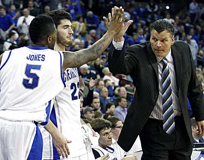 Creighton guard Josh Jones high-fives coach Greg McDermott during the Bluejays' win. (US Presswire)