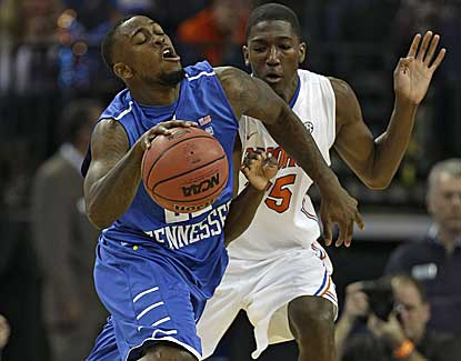 Middle Tennessee forward Jason Jones is fouled by Florida forward DeVon Walker. (AP)