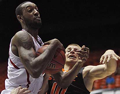 NC State's C.J. Leslie battles for a rebound with Phil Forte of Oklahoma State on Sunday. (AP)
