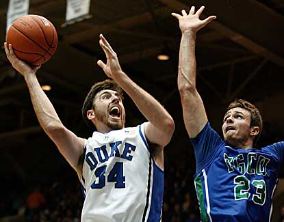 Duke forward Ryan Kelly puts up a shot over FGCU's Eddie Murray in the Devils' 88-67 win.  (US Presswire)
