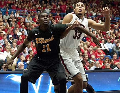 Arizona forward Grant Jerrett battles with Long Beach State's James Ennis during the first half. (US Presswire)