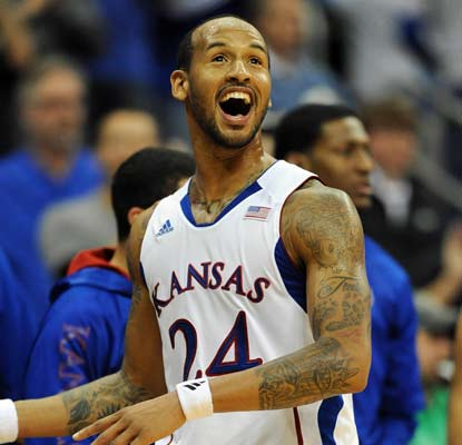 Kansas' Travis Releford scores 21 of his 23 points in the first half to help the Jayhawks win the CBE Classic title.  (US Presswire)