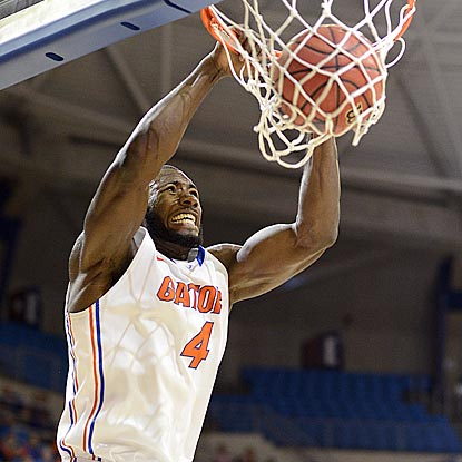 Patric Young notches his easiest two points of the evening during Florida's dominant first half.  (AP)